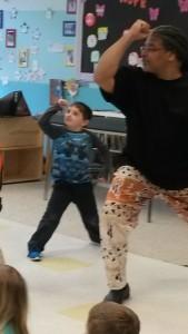 kid and teacher dancing