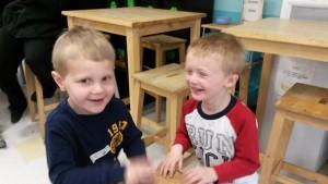 two kids having fun in class