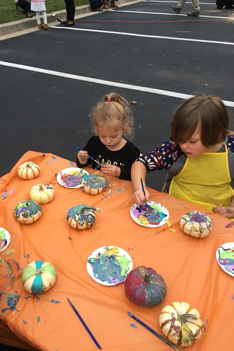 kids painting on pumpkins