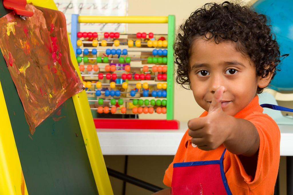 Little Child in Art Class Learning to Paint and Giving Thumb Up