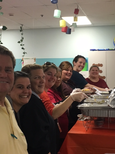 celebree teachers prepare food for children