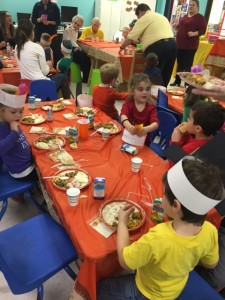 Children interact with one another during lunch