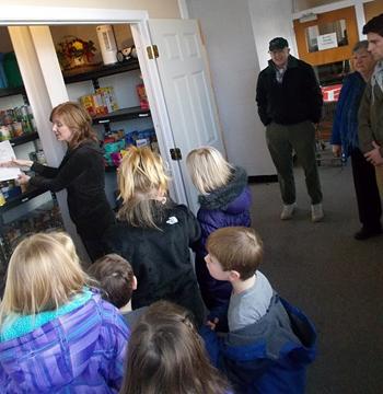 Celebree children tour food pantry.