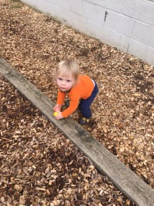 a toddler playing outside