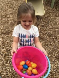 A kid having fun at kindergarten playground