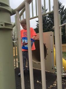 A kid playing on kindergarten playground