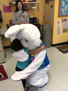 a toddler hugging celebree staff in bunny costume