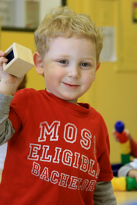 A kid showing off his toy block
