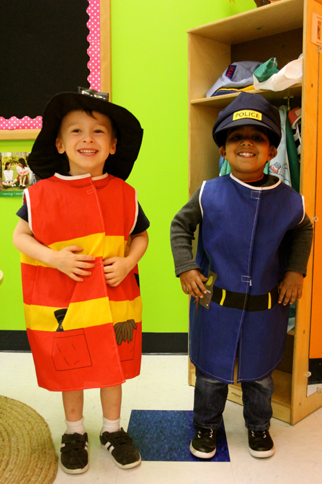 two boys dressed up as a fireman and a policeman