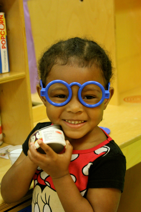 a girl in blue glasses