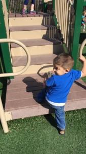 a toddler having fun outside