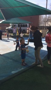toddler improves his social skill and confidence by interacting with others