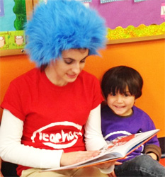 Teacher and student read Dr. Seuss together
