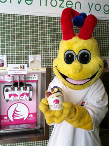 Celebree mascot Squiggle with yogurt named for him
