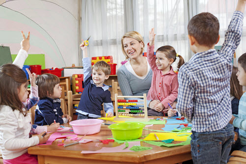 teacher with children at our child care programs in Bear, DE