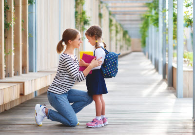 mother and daughter going to before and after school programs in Hampstead