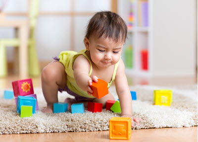 toddler playing with blocks at our toddler day care in Lutherville