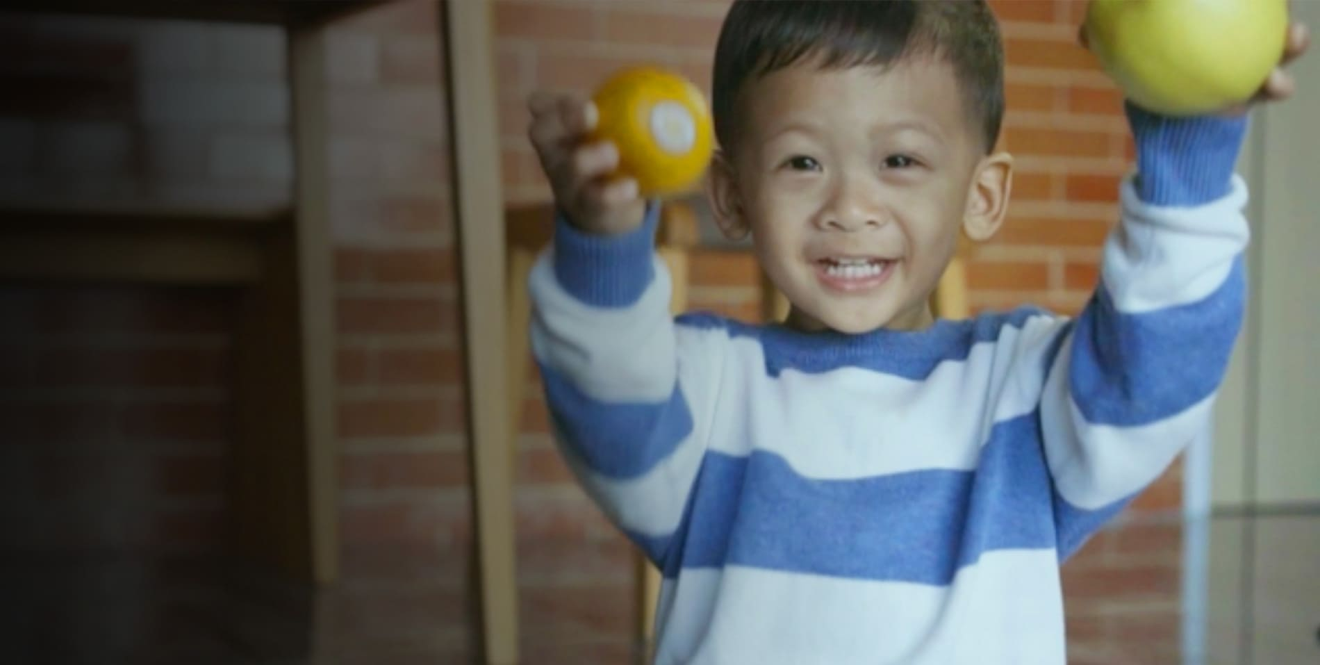 smiling child in stripe blue shirt in Child Care inEllicott City