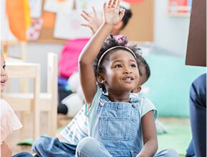 A child raising her hand