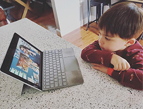 A child staring at screen