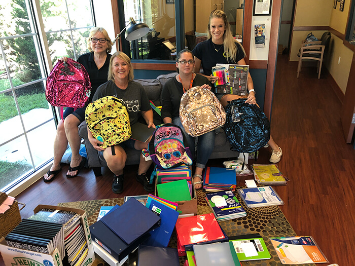 teachers with school supply donations